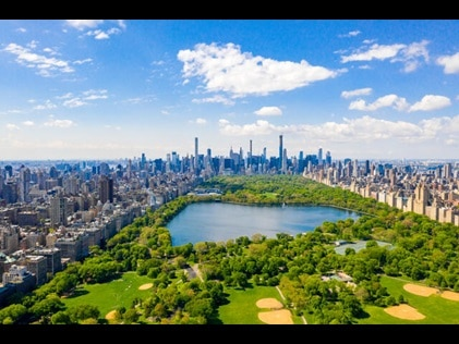 Aerial view of Central Park and New York City skyline.