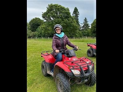 Hilton Grand Vacations Explorer riding an ATV in Dunkeld, Scotland.
