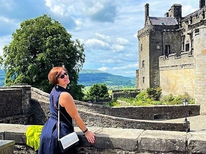 HIlton Grand Vacations Explorer posing at the top of Stirling Castle in Stirling, Scotland.