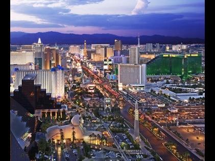 Aerial view of the Las Vegas Strip with purple painted skies overhead.