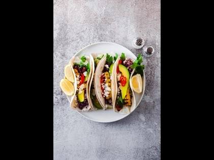 Overhead shot of plated tacos.