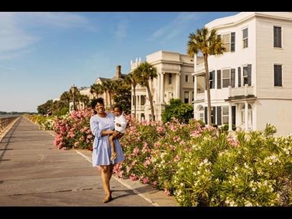 Mom and young son walking happily walking along the Battery in Charleston, South Carolina.