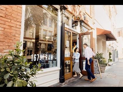 Couple walking into restaurant in Charleston, South Carolina.