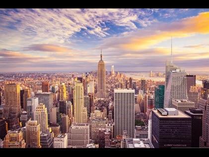 New York City skyline against pink painted skies.