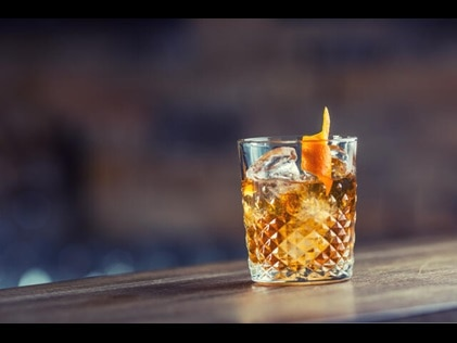 Picture of classic Old Fashioned cocktail at one of the best places to drink in NYC.