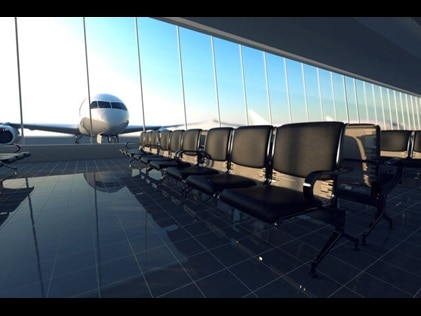 Interior shot of empty air port with plane parked outside window.