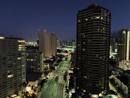 Downtown Honolulu lighting up the night sky with its city lights on Oahu in Hawaii.