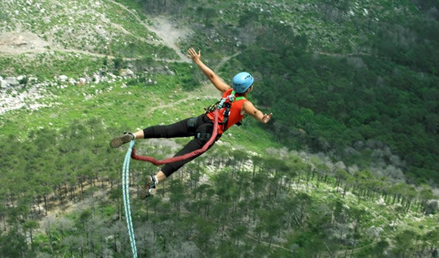 Women bungee jumping