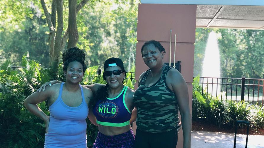 Hilton Grand Vacations Owner posing with friends after a workout at a Hilton Grand Vacations resort.