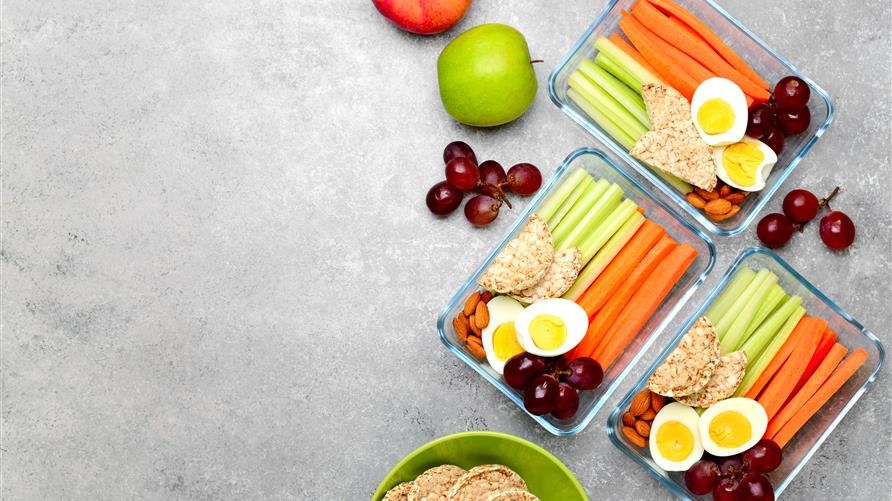 Meal prep containers with healthy food choices.
