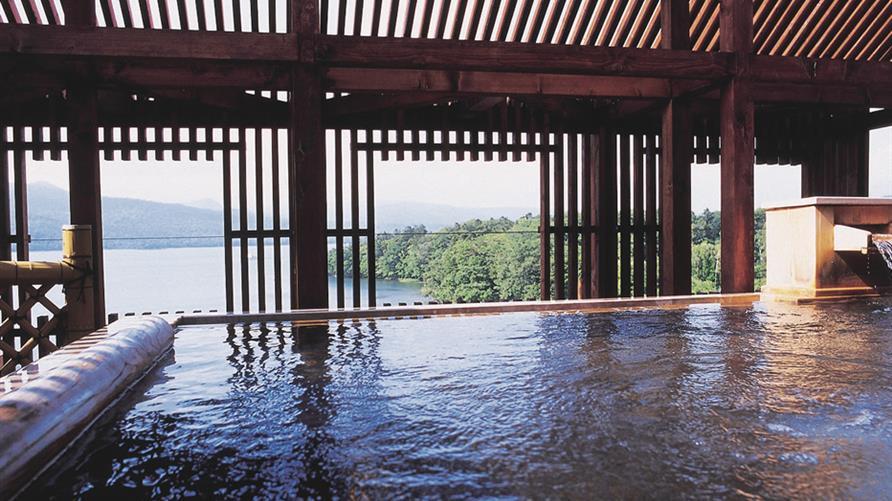 Serene waterfront indoor pool.