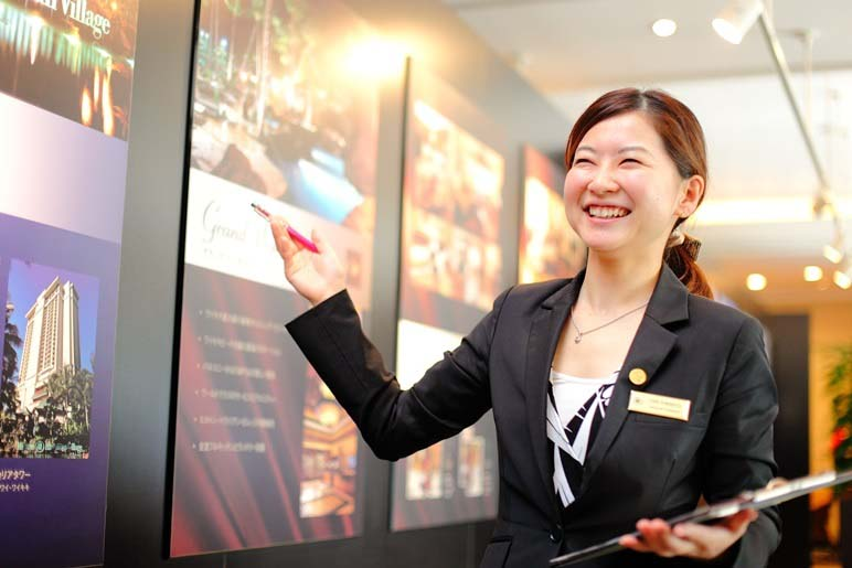Smiling Hilton Grand Vacations Sales Executive during a timeshare sales presentation.