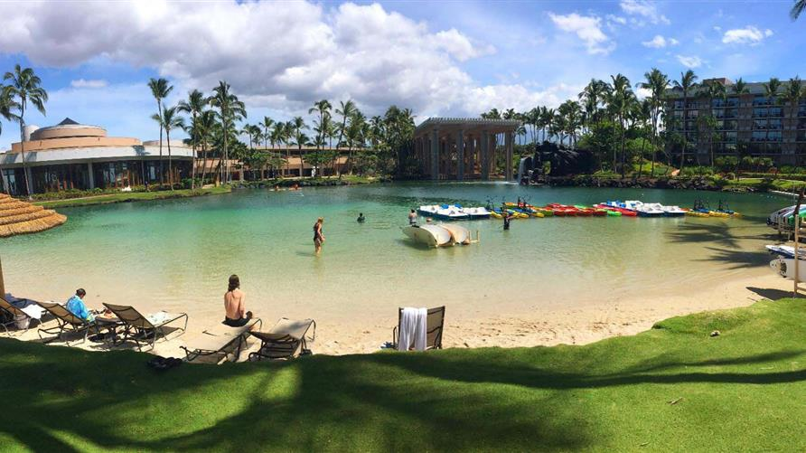 People swimming in the lagoon at Hilton Waikoloa Village on the Big Island.