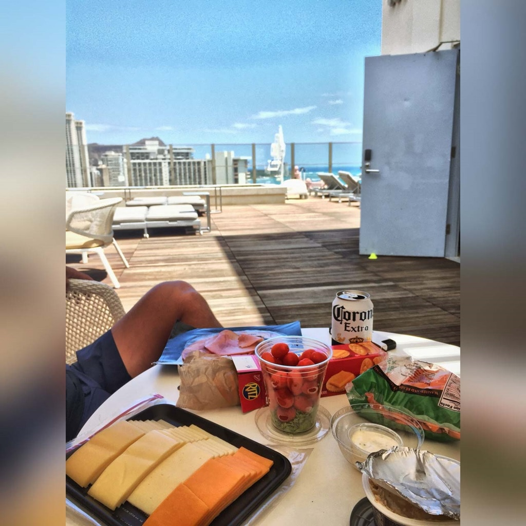 Snacking at the Hokulani Waikiki rooftop bar