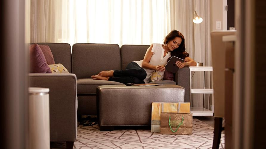 Woman reading on a couch.
