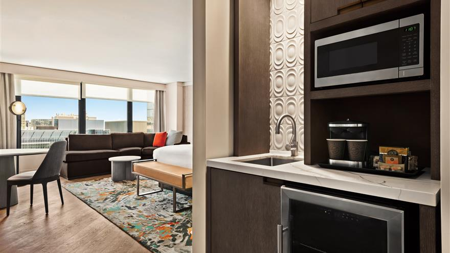 Kitchen and living area at Hilton Grand Vacations Chicago Downtown /Magnificent Mile located in Illinois.