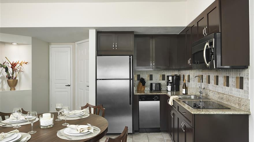 Dining and kitchen area at Hilton Grand Vacations at McAlpin-Ocean Plaza located in Miami, Florida.