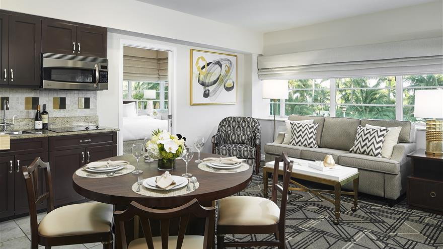 Dining and living area at Hilton Grand Vacations at McAlpin-Ocean Plaza located in Miami, Florida.