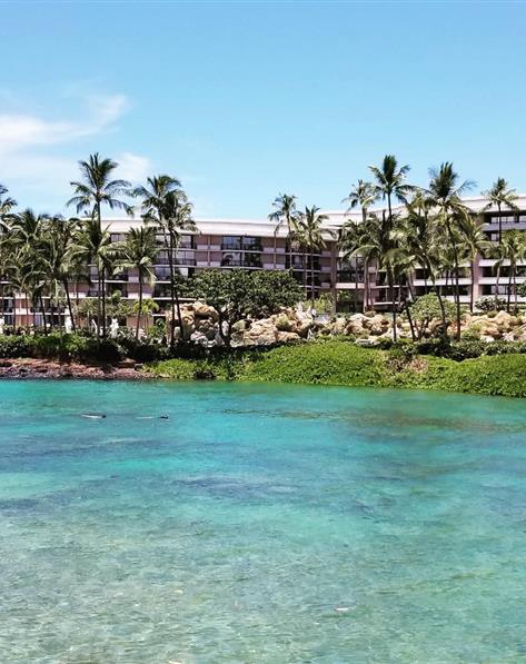 Small, clear lagoon in front The Bay Club at Waikoloa Beach Resort located on the Big Island, Hawaii.