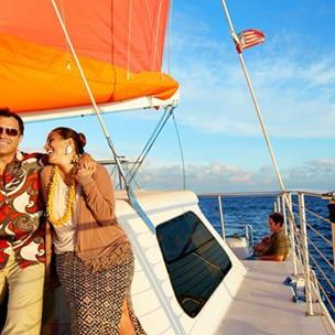 Couple on colorful sailboat