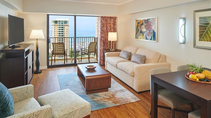 Living area in one bedroom suite at Kalia Suites by Hilton Grand Vacations located at Waikiki Beach, Oahua.