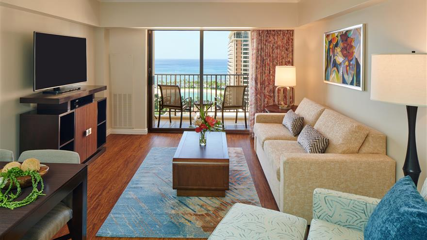 Living area with an ocean view at Kalia Suites by Hilton Grand Vacations located at Waikiki Beach, Oahua.