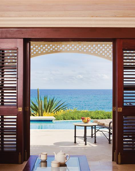 View from patio to the beach at Hilton Grand Vacations at The Crane located in St. Phillip, Barbados.