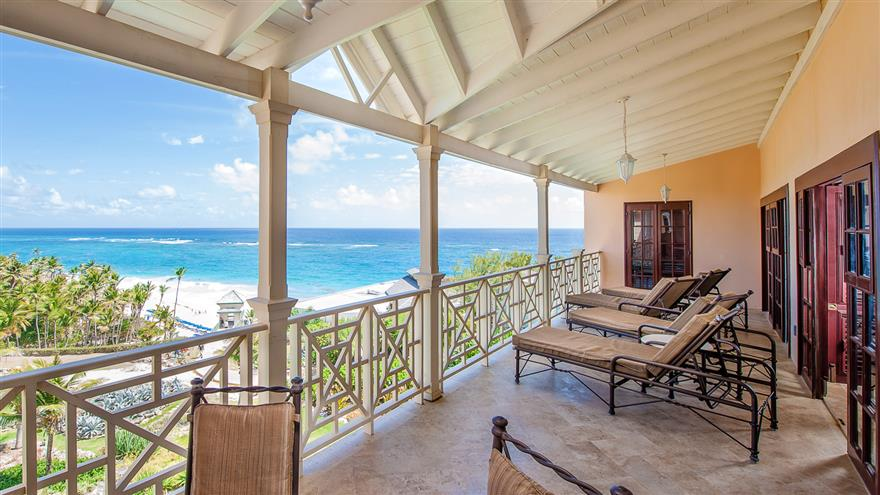 Patio overlooking beach at Hilton Grand Vacations at The Crane located in St. Phillip, Barbados.