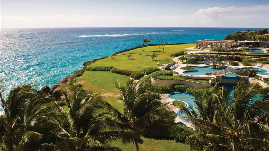 Beach, green lawns and pools at Hilton Grand Vacations at The Crane located in St. Phillip, Barbados.