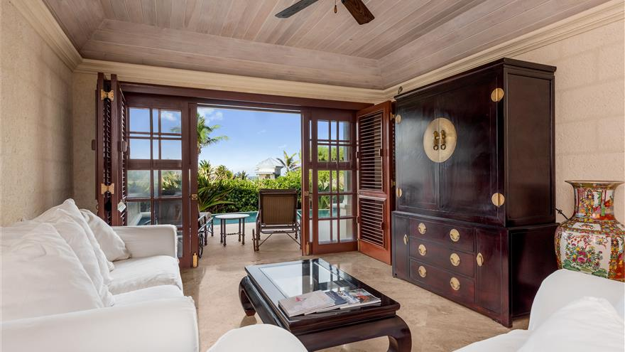 Living area with open patio at Hilton Grand Vacations at The Crane located in St. Phillip, Barbados.