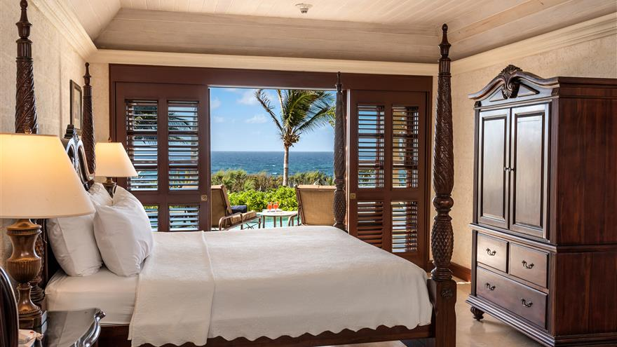 Bedroom with patio at Hilton Grand Vacations at The Crane located in St. Phillip, Barbados.
