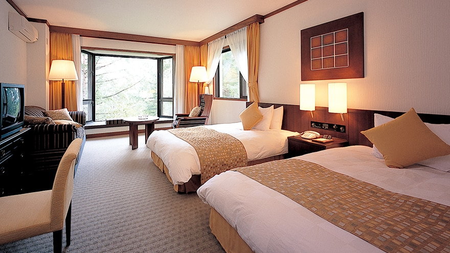 Bedroom with two rooms at Hotel Harvest Tateshina.