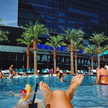 Lounging poolside at Elara by Hilton Grand Vacations located in Las Vegas, Nevada.