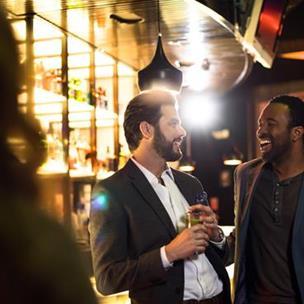 Couple enjoying a drink at a bar.