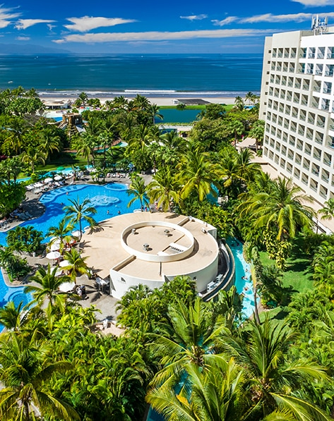 Overhead view of the resort pool and the ocean at The Grand Mayan Nuevo Vallarta located in Mexico.