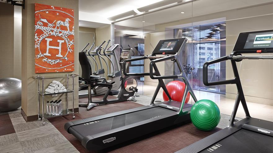 Treadmills, yoga balls and more at the fitness center at The Quin by Hilton Club located in New York.