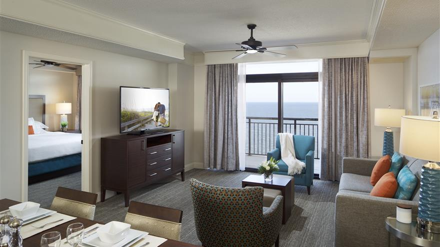 Living room and dining room at Hilton Grand Vacations at Anderson Ocean Club located in Myrtle Beach, South Carolina.