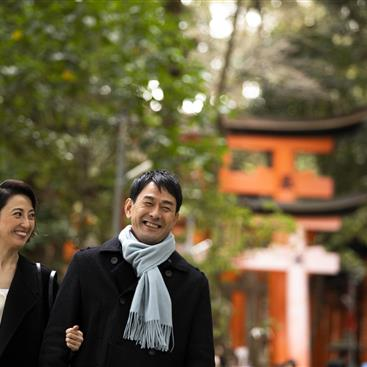 Couple walking down a path in Japan
